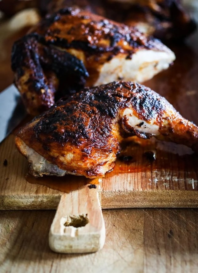 Portuguese Chicken with Crispy Potatoes...smokey spicy, crispy skinned tender chicken baked over sliced potatoes...my favorite chicken recipe! | www.feastingathome.com