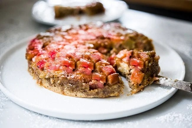 A gluten free Upside Down Rhubarb Cake made with Almond Flour. Deliciously addictive, perfect for Spring. | www.feastingathome.com