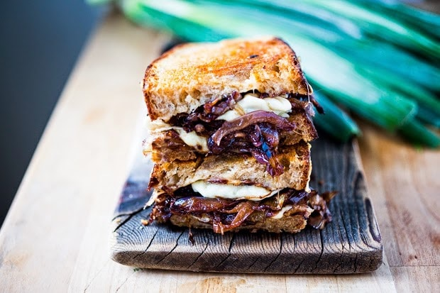 A delicious French Onion Grilled Cheese Sandwich with Caramelized onions, melty Gruyere and toasty bread. Serve with a salad and you have dinner!| www.feastingathome.com