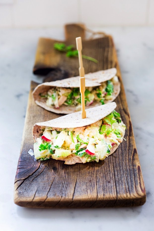 Picante Tuna Salad Tacos with cilantro, jalapeño, radish, cucumber and avocados...a healthy fast, 10 minute lunch that is full of protein and flavor!
