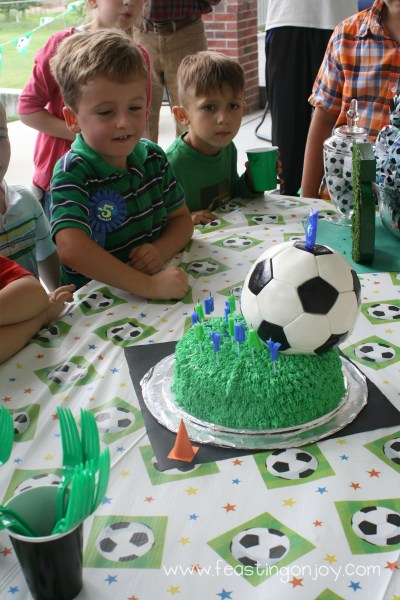 Singing Happy Birthday with Soccer Ball Cake