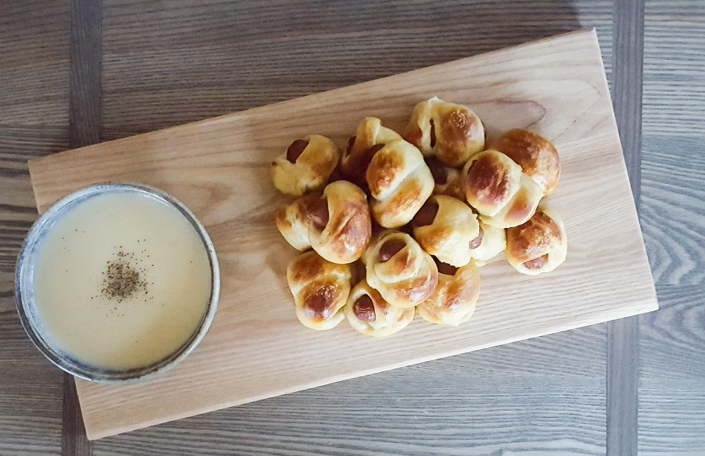 Pretzel Pastry Pigs with Hard Cider Cheese Sauce | Feast In Thyme