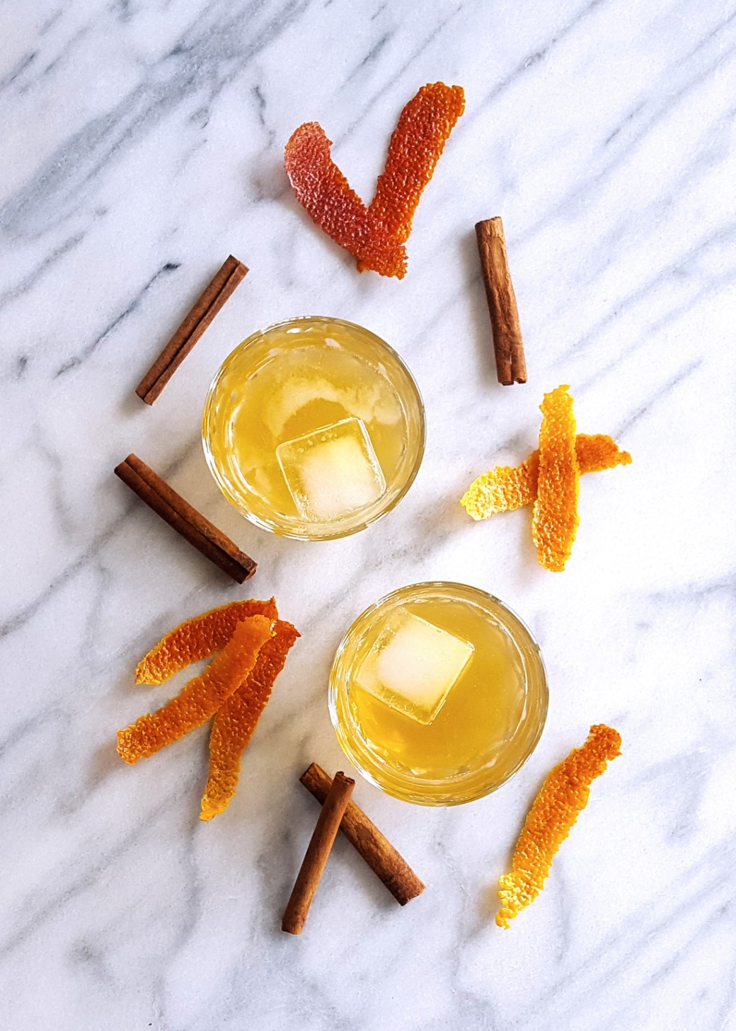 With a rich cinnamon syrup & the scent of blood orange, this Cinnamon Spiced Old Fashioned Cocktail will keep you (and your company) cozy on even the chilliest days. | FeastInThyme.com