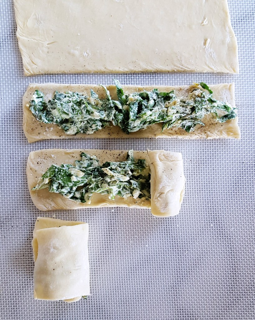 Rolling up Spinach & Artichoke Pastry Swirls | FeastInThyme.com