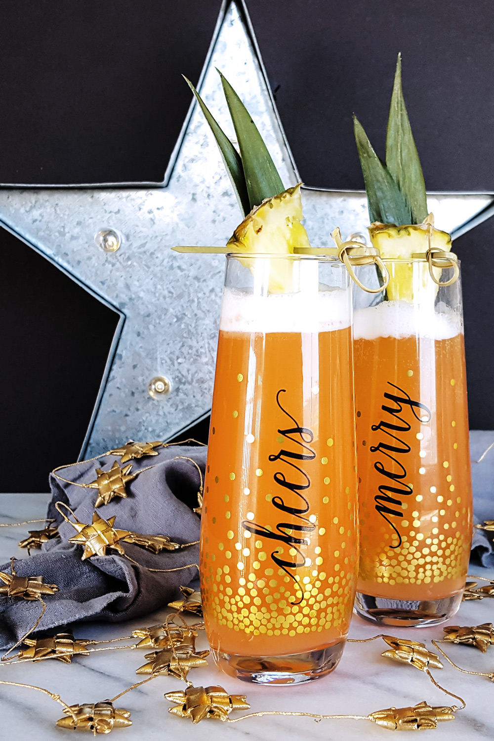 Fizzy, bright, & not too sweet, the Ginger Jungle Bird is a festive sparkling cocktail perfect for celebrating any occasion! Enjoy a touch of the tropics all year long. | FeastInThyme.com