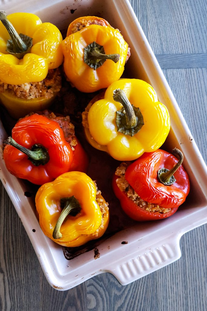 A casserole dish full of cooked easy stuffed bell peppers.