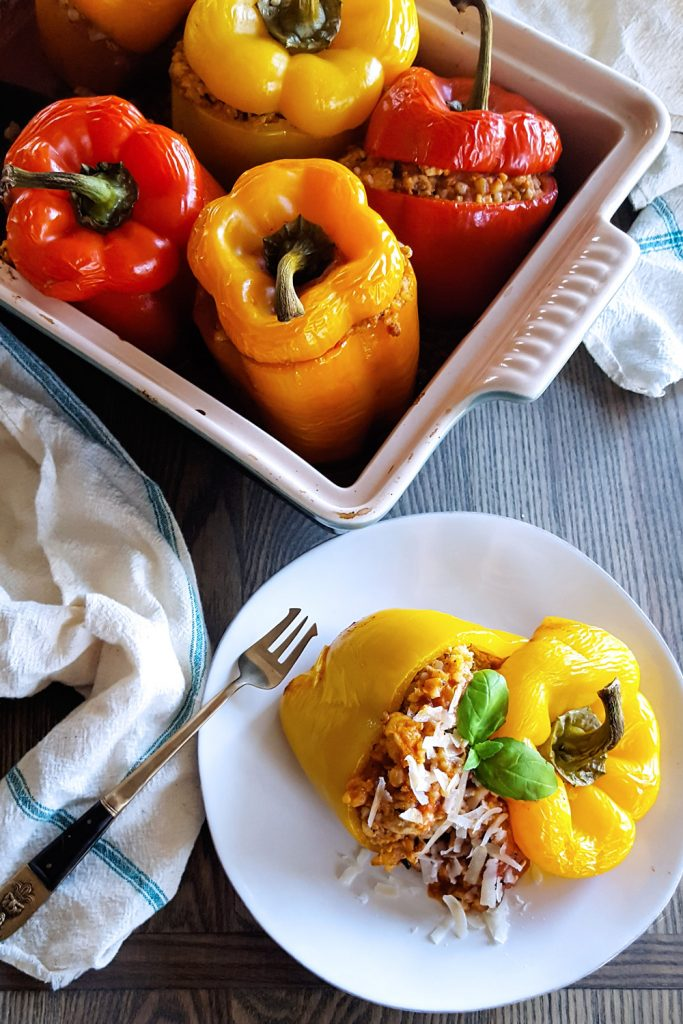 Making these Stuffed Bell Peppers with a filling of brown rice, creamy tomato sauce, fennel, and spices is easy enough for a #weeknightmeal or to #makeahead for a delicious lunch. Best of all, they are #LowFODMAP, #LowLactose, and naturally #GlutenFree! #mealplan #dinnertime   FeastInThyme.com