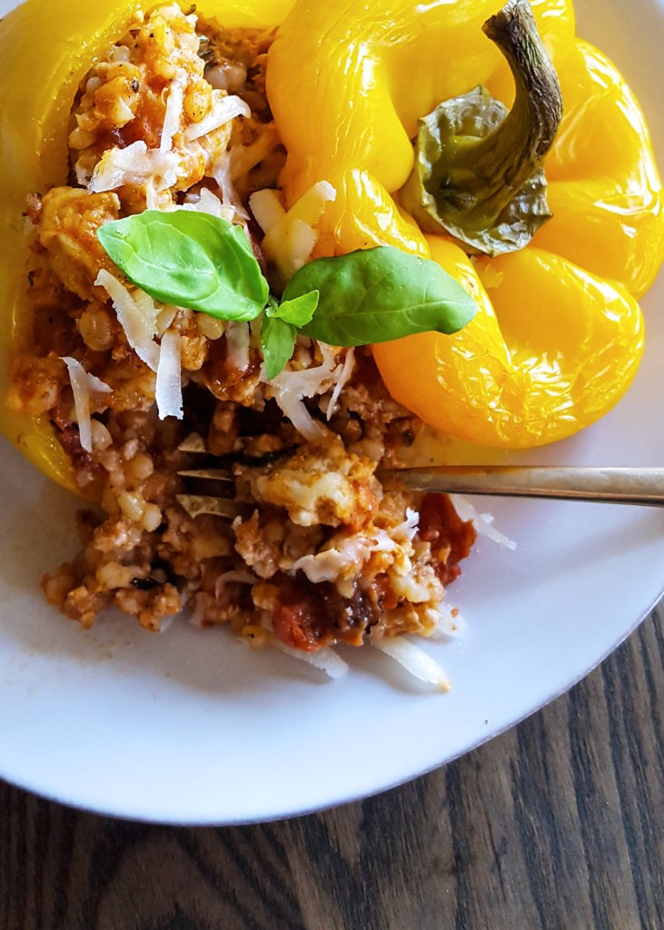 A serving of easy stuffed bell pepper with a fork.