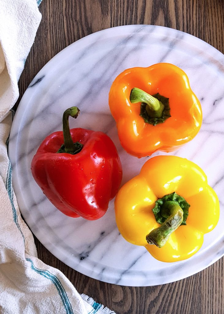 Red, yellow, and orange bell peppers.