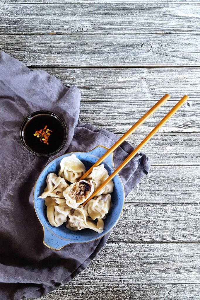 Simple Pork & Mushroom Dumplings with one cut open.