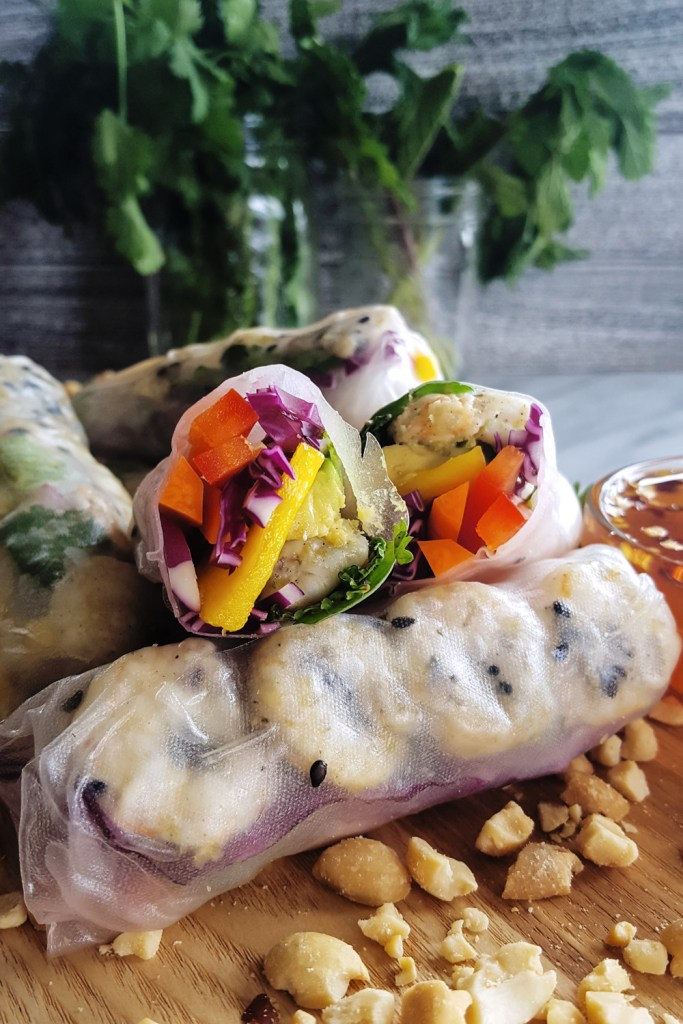 Packed with ripe mango, creamy avocado, and a rainbow of vegetables and herbs, these Sesame Lime Roasted Shrimp Summer Rolls are a #quick and #healthy meal option perfect for any day of the week. #easyrecipe #summerroll #shrimp | FeastInThyme.com
