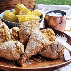 Served hot or cold, Oven Fried Cornmeal Crusted Picnic Chicken is a delicious main course for any potluck or camping trip. Crunchy and full of flavor, guests will hardly believe that this crowd-pleasing recipe is #GlutenFree, #DairyFree, and #FODMAP friendly! #lowFODMAP #chicken #potluck #picnic #nogluten | FeastInThyme.com