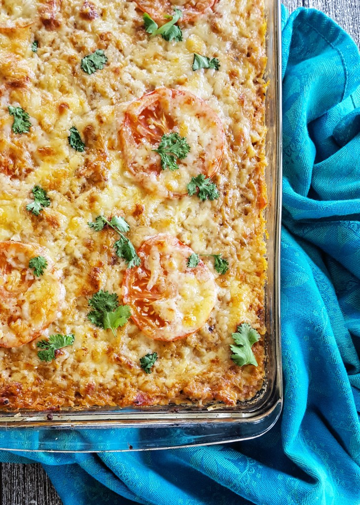 Close-up of a spaghetti squash taco casserole surrounded with a blue cotton napkin.