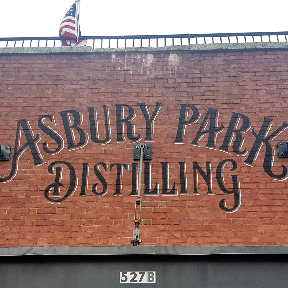 Painted sign outside the front door of the Asbury Park Distilling Co. | A Review from FeastInThyme.com