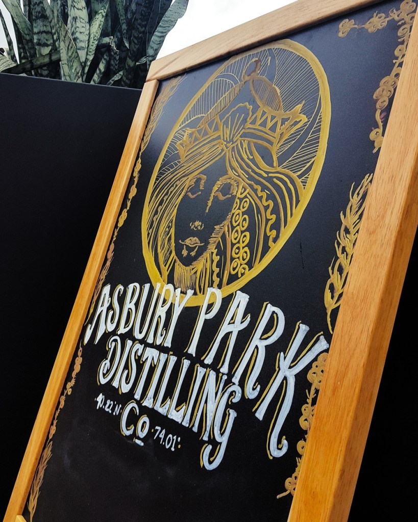 A sign with the mermaid logo and wordmark of Asbury Park Distilling Co. | A Review from FeastInThyme.com
