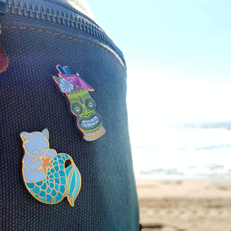 Enamel pins on a backback at Asbury Park Beach