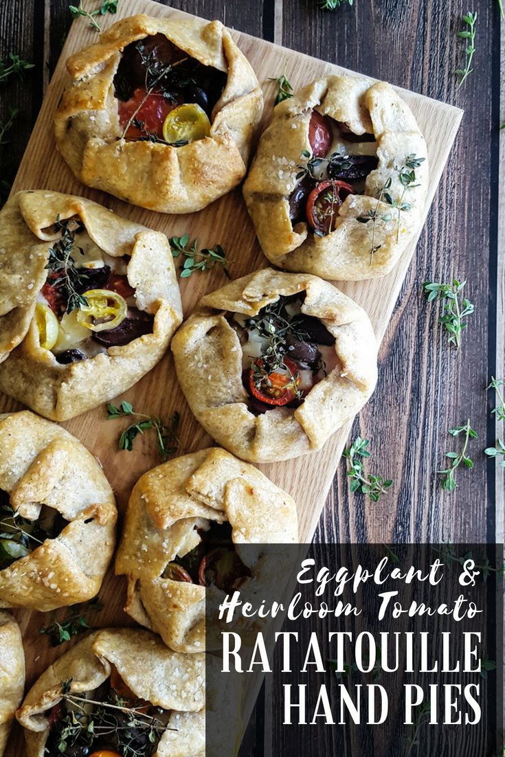 Rustic Ratatouille Hand Pies are stacked with layers of roasted #eggplant, ripe #tomato, melty #cheese, & a sprinkling of fresh herbs & briny olives. Wrapped up in a hearty cornmeal crust, these travel-ready #vegetarian galettes are perfect for any #picnic or #potluck.  #handpies #cornmeal #summer | FeastInThyme.com