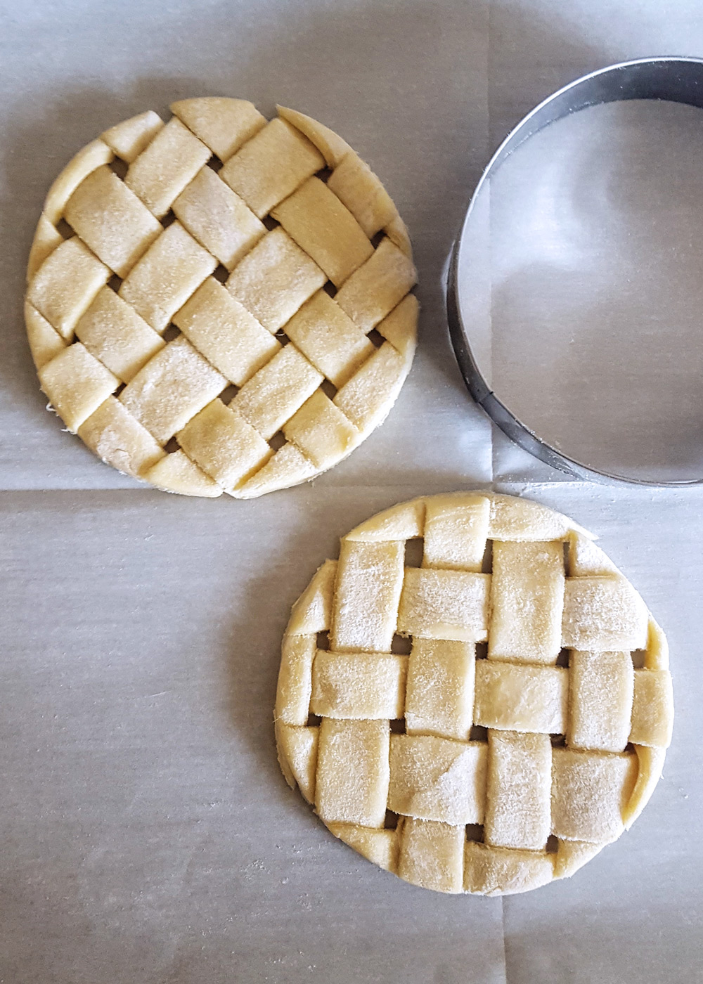 Woven puff pastry strips cut into circles with a cookie cutter. | FeastInThyme.com