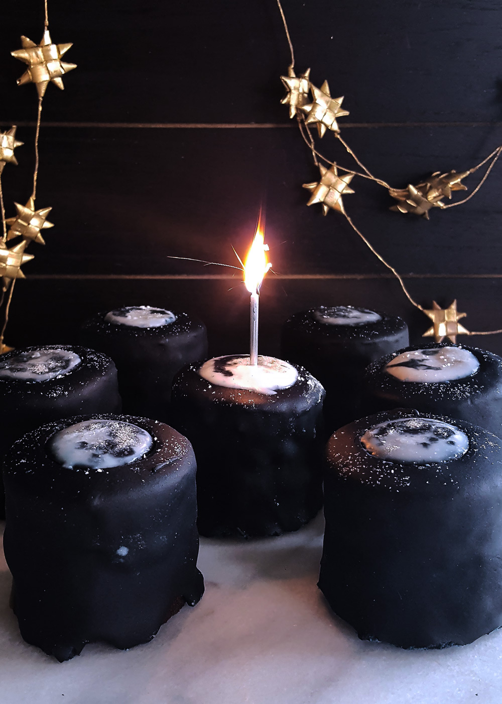 A candle lit in one full moon chocolate layer cake! FeastInThyme.com