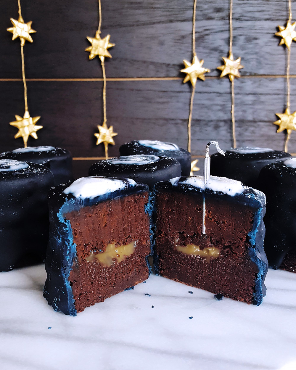 A chocolate layer cake cut up to reveal the caramel filling. FeastInThyme.com