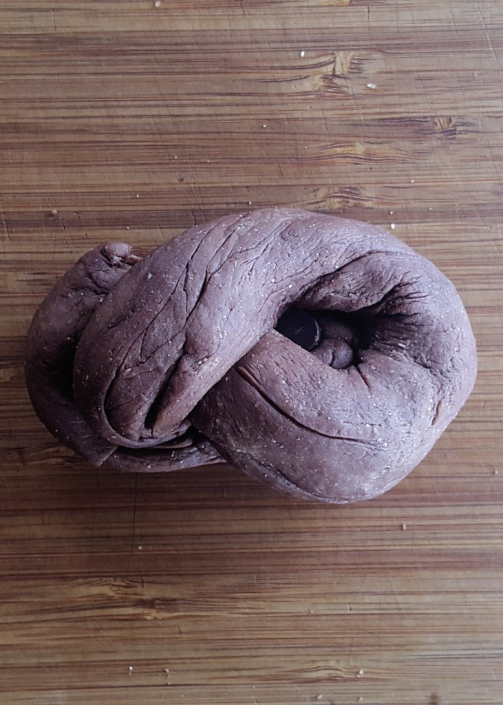 The dough folded, twisted, and tucked into itself to make a knot.