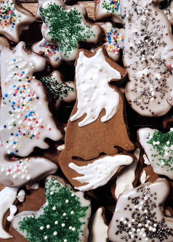 A pile of gingerbread cookies with multicolor sprinkles.