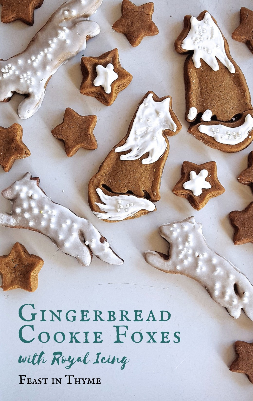 With warm spices, dark molasses, and only a handful of ingredients, these gingerbread cookie foxes are a classic addition to any cookie platter. #holidays #cookies #winter #gingerbread | FeastInThyme.com