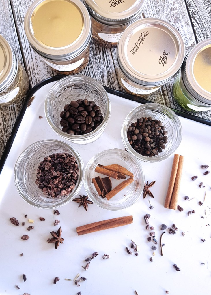 Overhead shot of a tray of jars filled with various botanicals.