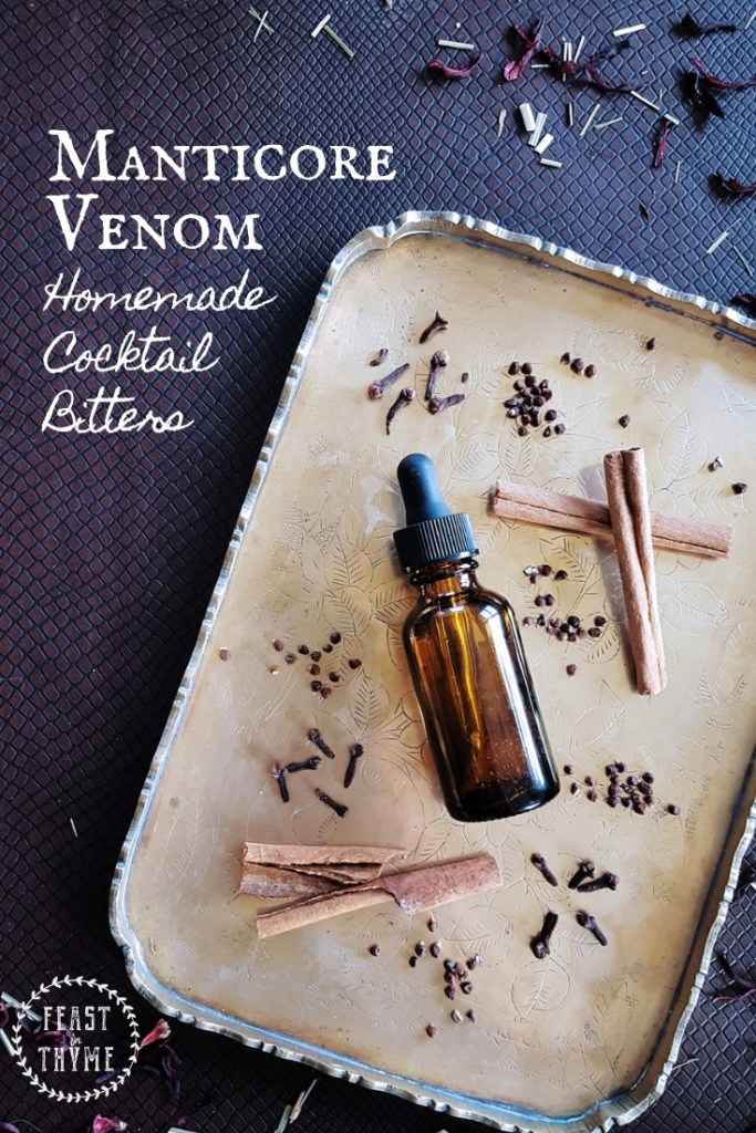 Manticore Venom inspired bitters surrounded by cinnamon sticks, grains of paradise, and cloves.