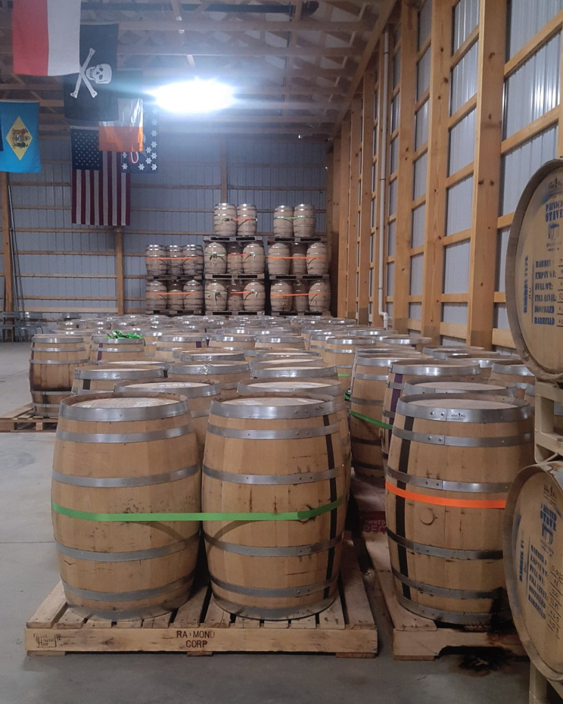 A view of the barrels aging in Painted Stave's barrel house.