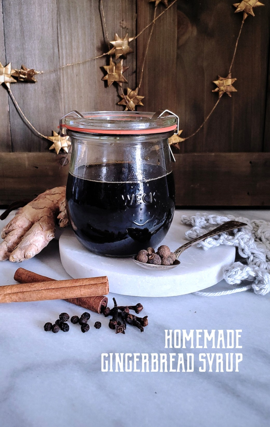Full of brown sugar, spice, and everything nice, this homemade gingerbread syrup is a lovely addition to your coffee and cocktails this winter season. #gingerbread #holidays #DIY | FeastInThyme.com