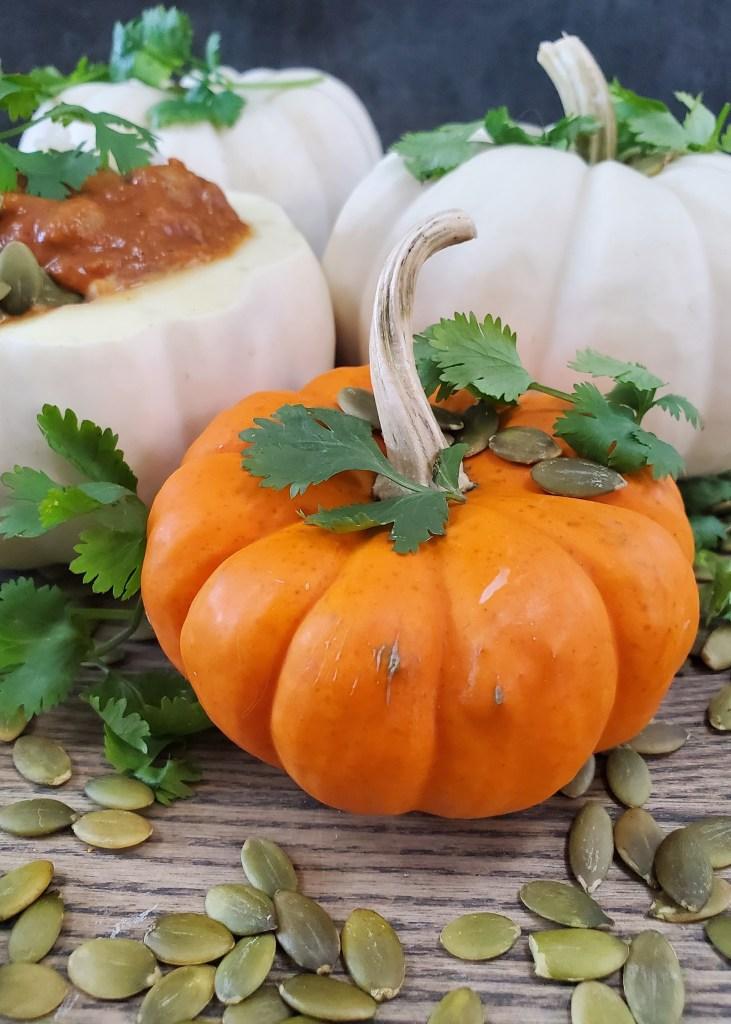 Baby orange pumpkin showered in pepitas and cilantro.