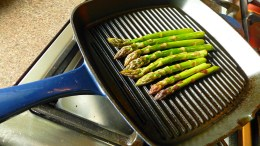 asparagus laid on the griddle