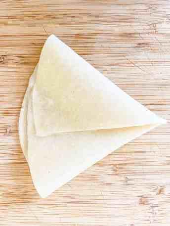 fold into triangle. Triangle samosa wrap.