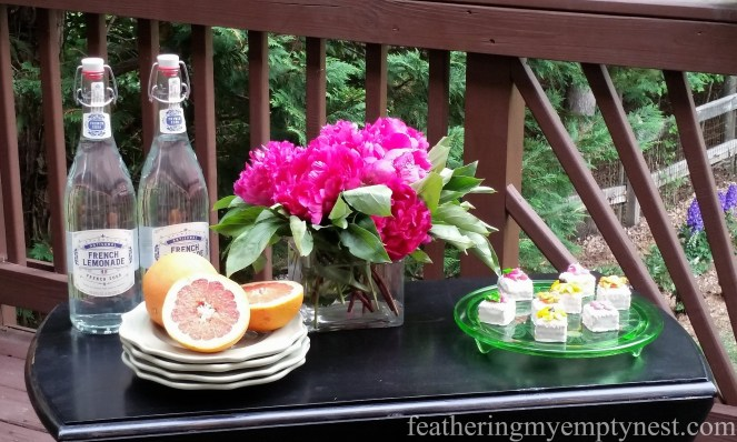 Drop leaf table functions as a server for a Romantic Flower-themed Summer Tablescape