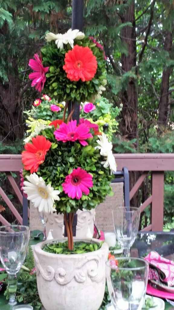 Towering Gerber Daisy studded topiary on Romantic Flower-themed Summer Tablescape