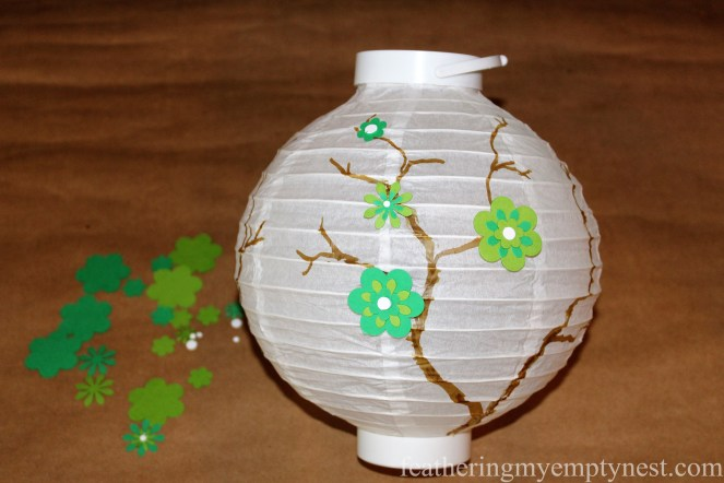 Glue punched out flowers along the branches on lantern --How To Embellish Chinese Lanterns--featheringmyemptynest.com