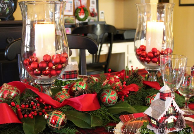 Hurricanes and holiday greenery studded with ornaments make a festive table runner --Pancakes & Plaid: A Christmas Breakfast Table