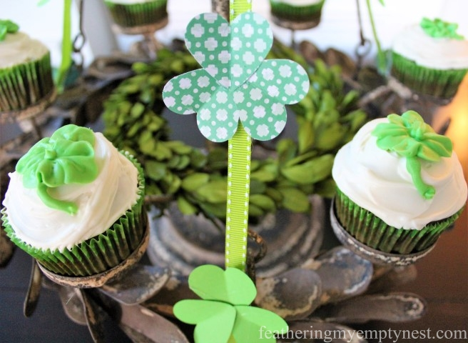 Make paper Shamrocks out of punched out heart-shapes to decorate your St. Patrick's day party -- St. Patrick's Day Irish Cream Shamrock Cupcakes