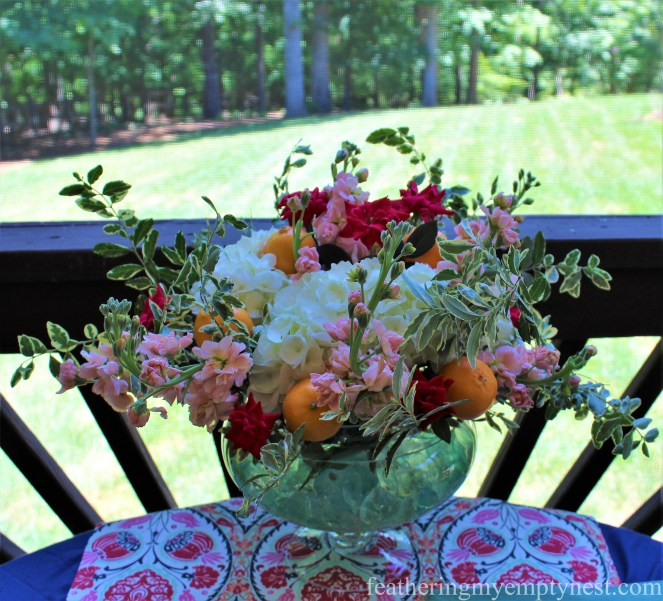 Flower arrangement with Hydrangeas, Stock, Roses, Privet, and Mandarin Oranges for An Impromptu Outdoor Dining Table For Two