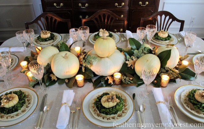 A Nature-Inspired Elegant Thanksgiving Tablescape featuring a magnolia runner, white pumpkins and touches of gold.