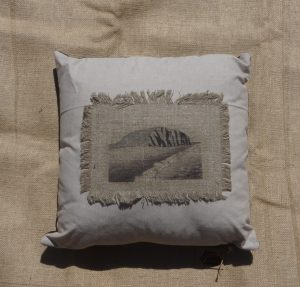 West Bay Cliff painting printed onto a cushion.