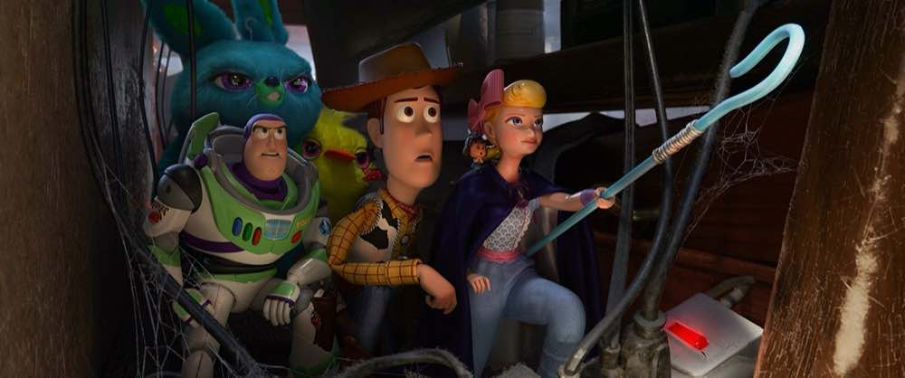 Toy Story 4 Woody, Bo Peep, Buzz Lightyear and the bunnies behind furniture