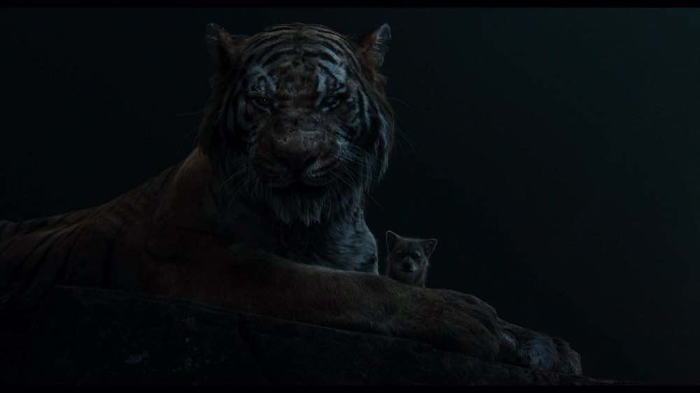 The Jungle Book 2016 Shere Khan holding a wolf cub