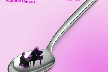 A Small Man Playing The Piano In A Massive Spoon