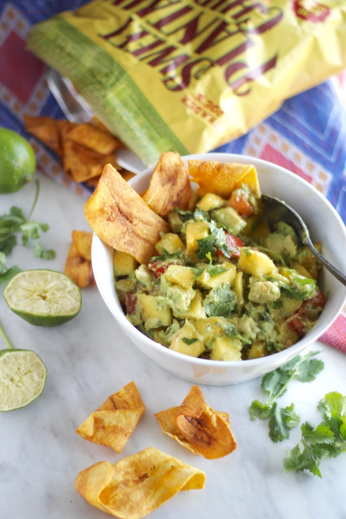 Easy Mango Guacamole - a fresh, colorful chunky guacamole with mango, lime, and cilantro! Perfect for an appetizer or on top of your favorite protein! |fedandfulfilled.com