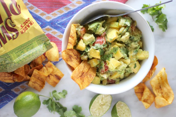 Easy Mango Guacamole - a flavorful, colorful guacamole featuring juicy mangos! Whip this up in minutes and enjoy with your favorite chips! | fedandfulfilled.com