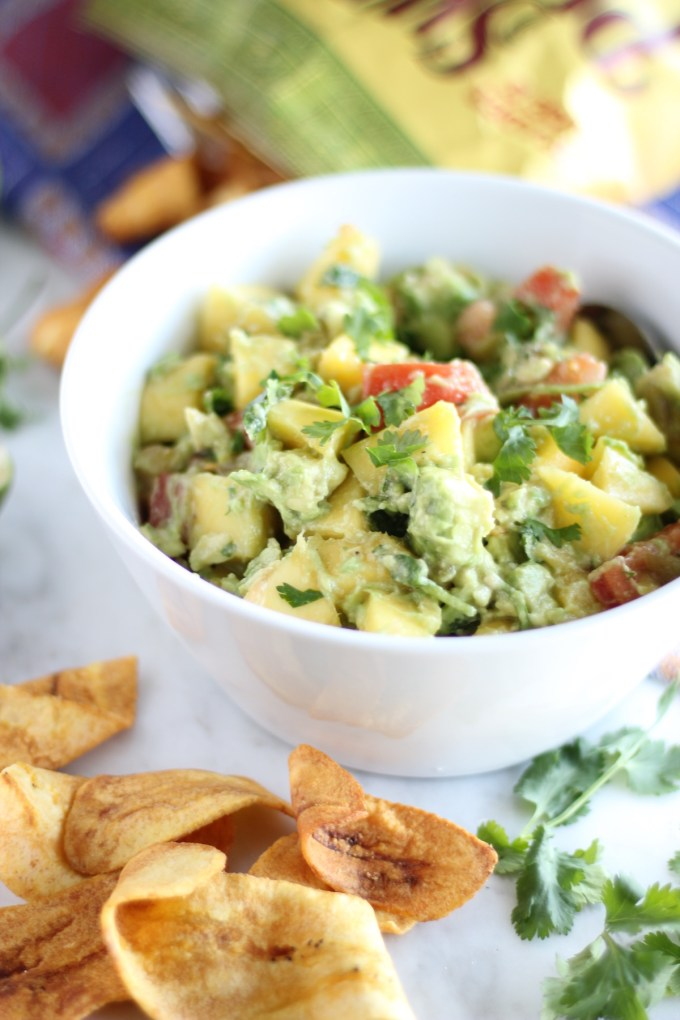 Easy Mango Guacamole - a sweet, spicy, chunky-style guacamole that you won't be able to stop eating! It's awesome with plantain chips! |fedandfulfilled.com