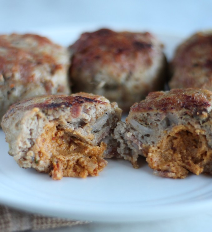 Stuffed Bacon Turkey Burgers - these delicious, paleo turkey burgers are full of bacon, dairy-free cheese, caramelized onions, and slathered with avocado dressing! SO GOOD! | fedandfulfilled.com