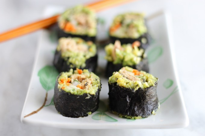 Salmon Sushi Rolls - these AIP-friendly sushi rolls are packed full of cooked salmon, carrots, cukes, turmeric cauliflower rice, and ginger guacamole! | fedandfulfilled.com